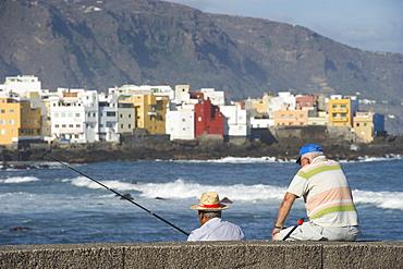 Fishermen at Playa Jardin, Puerto de la Cruz, Tenerife, Canary Islands, Spain, Europe
