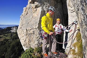 Young man belaying young woman, Kampenwand, Chiemgau Alps, Chiemgau, Upper Bavaria, Bavaria, Germany