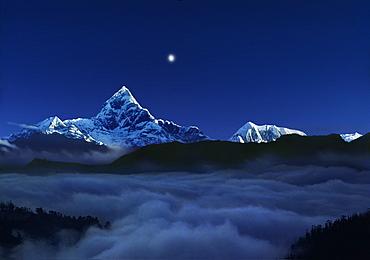 Sunrise with moon over the holy Machapuchare, Pokhara, Gandaki, Nepal, Asia