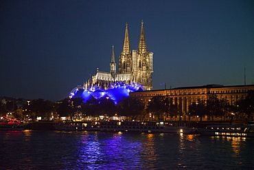Cologne Cathedral and Cologne Musical Dome at night seen from Rhine river cruise ship MS Bellevue, Cologne, North Rhine-Westphalia, Germany, Europe