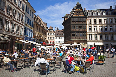 People at outdoor cafe with Restaurant Maison Kammerzell in background at Cathedral Square, Strasbourg, Alsace, France