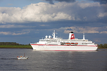 Cruise ship MS Deutschland and small boat on Elbe river, Stade, Lower Saxony, Germany, Europe