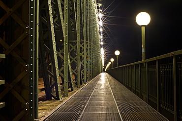 Deserted railway bridge and street lamp at night, Linz, Upper Austria, Austria