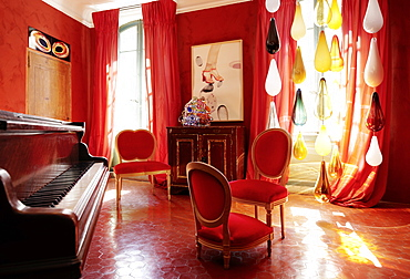 Music room with piano from author Andre Gide from 1900, B and B Chambre Avec Vue, Luberon, France