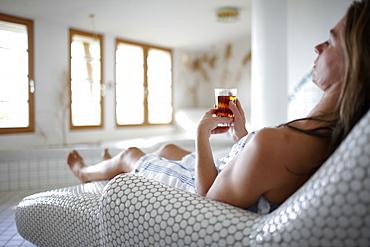 Woman enjoying a cup of tea in a spa hotel, Am Hochpillberg, Schwaz, Tyrol, Austria