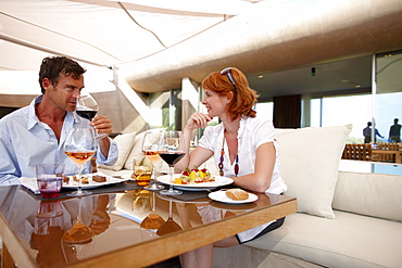 Couple having lunch in outdoor area of a hotel restaurant, Ramatuelle, Provence-Alpes-Cote d'Azur, France
