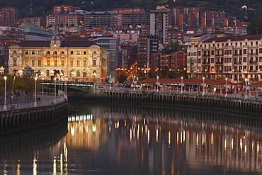 Town hall at the river Rio Nervion in the evening, Bilbao, Province of Biskaia, Basque Country, Euskadi, Northern Spain, Spain, Europe