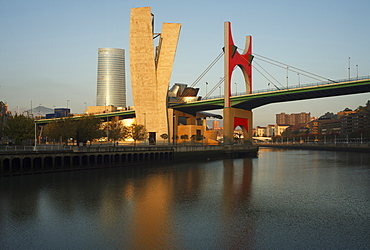 High rise building Torre Iberdrola and Guggenheim Museum of modern and contemporary art with bridge Puente de la Salve in the evening light, Rio Nervion, Bilbao, Province of Biskaia, Basque Country, Euskadi, Northern Spain, Spain, Europe