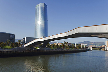High rise building Torre Iberdrola and bridge Puente Arupe in the sunlight, Rio Nervion river, Bilbao, Province of Biskaia, Basque Country, Euskadi, Northern Spain, Spain, Europe