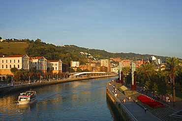 Universidad de Deusto, university at the river Rio Nervion in the evening light, Guggenheim Museum of modern and contemporary art, Bilbao, Province of Biskaia, Basque Country, Euskadi, Northern Spain, Spain, Europe