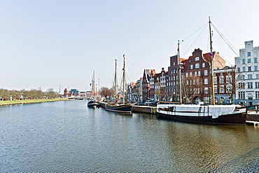 Houses with boats along the river shore, Lubeck, Schleswig Holstein, Germany