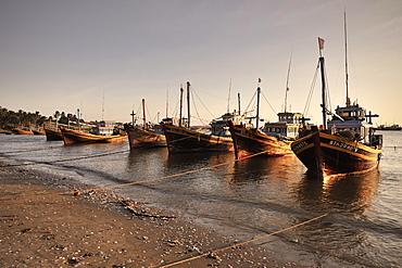 Many colourful fishing boats on the beach of Mui Ne, Vietnam, South China Sea