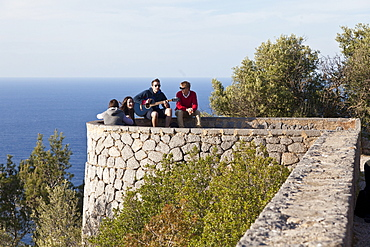 Young people with guitar, Son Marroig, former country residence of archduke Ludwig Salvator from Austria, Son Marroig near Deia, Tramantura, Mallorca, Spain