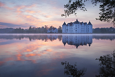 Gluecksburg moated castle at dawn, Flensburg fjord, Baltic Sea, Schleswig-Holstein, Germany, Europe