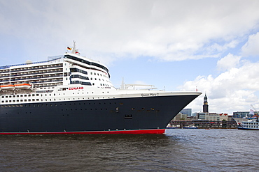 Cruise ship Queen Mary 2 entering port, in front of St Michaelis church, Hamburg, Germany, Europe