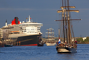 Sailing ship in front of cruise ship Queen Mary 2 at harbour, Hamburg Cruise Center Hafen City, Hamburg, Germany, Europe