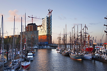 Sailing ships in front of Hafen City and Elbphilharmonie at dusk, Hamburg, Germany, Europe