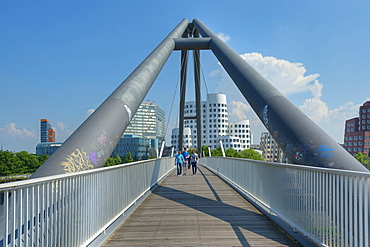 Pedestrian bridge at the Neuer Zollhof with Gehry buildings, Media harbour, Dusseldorf, Northrhine-Westphalia, Germany, Europe