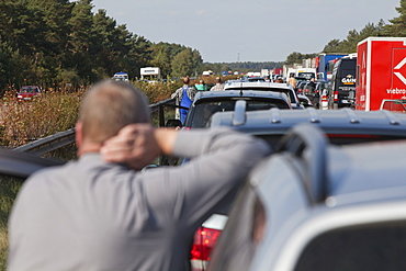 Vehicles at a standstill, people waiting in a traffic jam on a German Autobahn, Germany