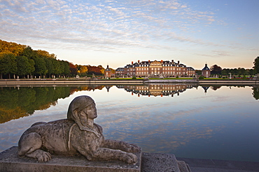 Sphinx at the stairs of the pond at dusk, Nordkirchen moated castle, Muensterland, North Rhine-Westphalia, Germany, Europe