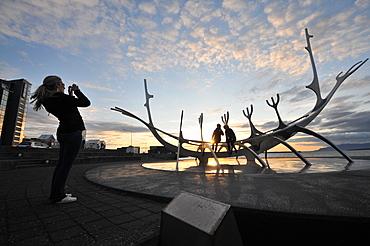 Sun voyager monument on the waterfront at dusk, Saebraut, Reykjavik, Iceland, Europe