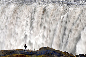 Man in front of the waterfall Dettifoss, North Iceland, Europe