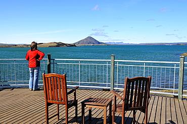 Woman looking over Myvatn lake, Skutustadir, Nordurland eystra, Iceland