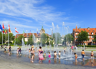 Children at the fountain at Place Rapp, Colmar, Alsace, France, Europe