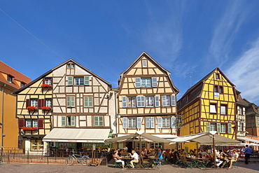 People in street cafes at the old town, Colmar, Alsace, France, Europe