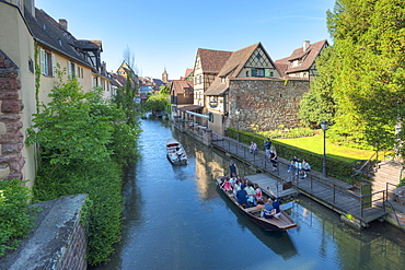 Tourists in boats on the Lauch river, Little Venice, Colmar, Alsace, France, Europe