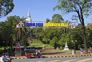 Rickshaw taxi in front of, the Stupa of Wat Phnom, Phnom Penh, capital of, Cambodia, Asia