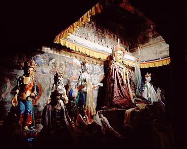 Buddha statues on the shrine at convent Temisgam, Chenrezig Gompa, Sham Trek, Ladakh, Jammu and Kashmir, India