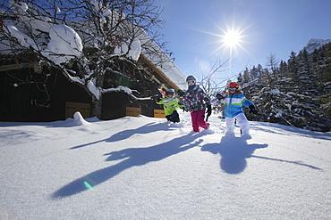 Children with skiing equipment, Vergalden, Gargellen, Montafon, Vorarlberg, Austria