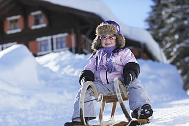 Girl (3 years) sledding, Gargellen, Montafon, Vorarlberg, Austria