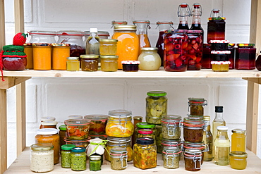Food larder with shelves of homemade products, Homemade