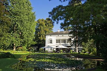 Pond and house at Merian Park, Brueglingen, Basel, Switzerland, Europe