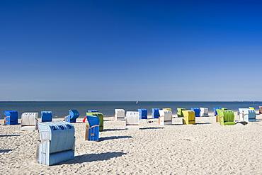 Colourful beachchairs on the beach under blue sky, Wyk, Foehr, North Frisian Islands, Schleswig-Holstein, Germany, Europe