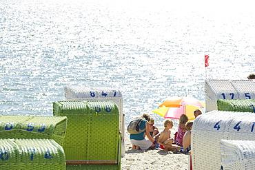Colourful beachchairs and children on the beach, Wyk, Foehr, North Frisian Islands, Schleswig-Holstein, Germany, Europe