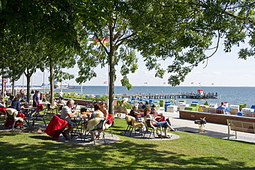 People at the promenade in the sunlight, Wyk, Foehr, North Frisian Islands, Schleswig-Holstein, Germany, Europe
