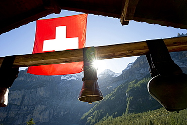 Swiss flag and cow bells at lake Oeschinensee, Kandersteg, Bernese Oberland, Canton of Bern, Switzerland, Europe