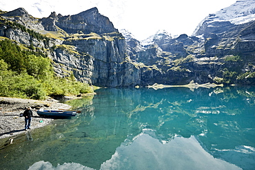 Angler at lake Oeschinensee, Kandersteg, Bernese Oberland, Canton of Bern, Switzerland, Europe