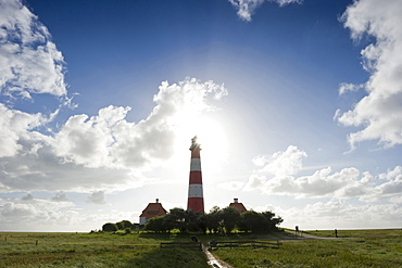 Backlit Westerheversand lighthouse, Westerhever, Wadden Sea National Park, Eiderstedt peninsula, North Frisian Islands, Schleswig-Holstein, Germany, Europe