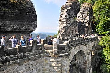 People on the stone bridge at the Bastei, Saxonien Switzerland, Saxony, Germany, Europe