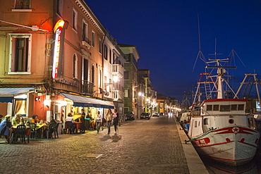 Ristorante Pizzeria Al Porto and fishing boats at dusk, Chioggia, Veneto, Italy, Europe