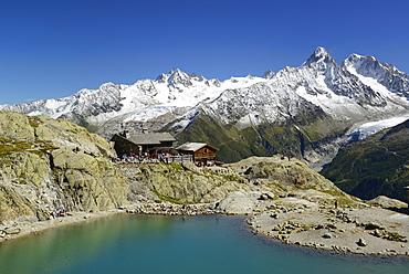 Lac Blanc with Chalet du Lac Blanc, Mont Blanc range in the background with Aiguille du Chardonnet, Aiguille d' Argentiere, Aiguille Verte and Grand Dru, Mont Blanc range, Chamonix, Savoy, France