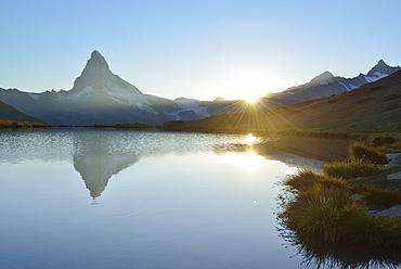 Matterhorn reflecting in mountain lake, Pennine Alps, Valais, Switzerland