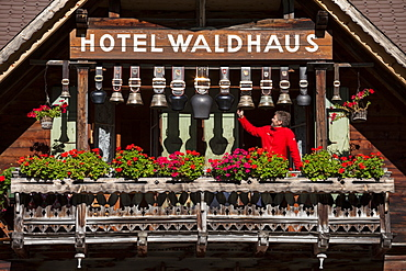 Cowbells on the balcony of Hotel Waldhaus, Gastern Valley, Bernese Oberland, Canton of Bern, Switzerland