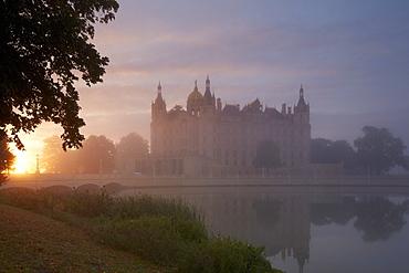 View of Schwerin castle at sunrise, Schwerin, Mecklenburg Western Pomerania, Germany, Europe