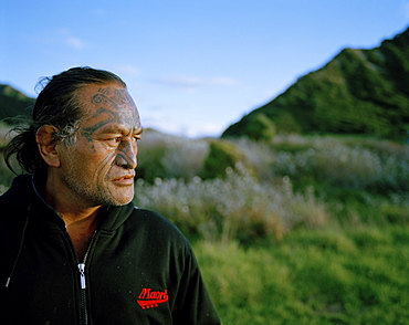 Mature Maori man with facial tatoo, Te Araroa, Eastcape, North Island, New Zealand