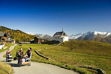 Hiking families at Bettmeralp, Canton of Valais, Switzerland, Europe